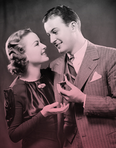 Photo of 1940s guy holding a ring for his gal
