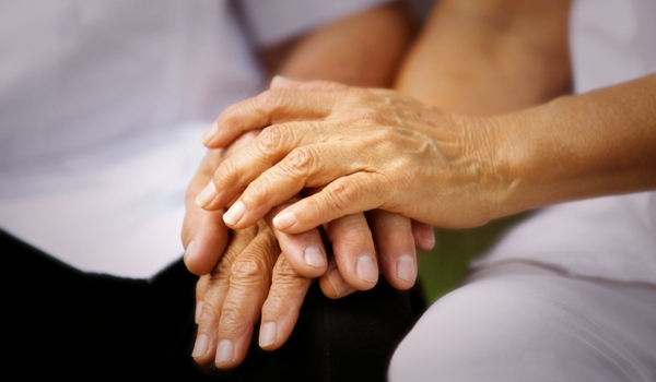 Photo of elderly hand holding