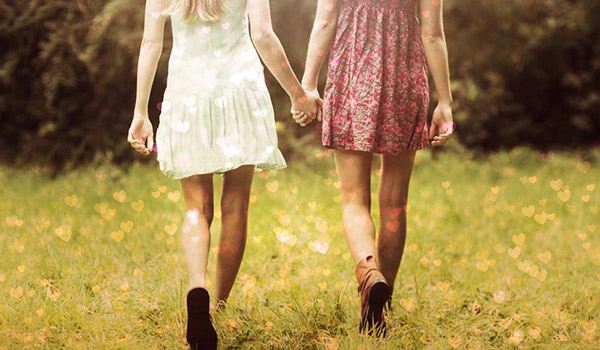 photo of two girls holding hands with Bokeh Hearts effect